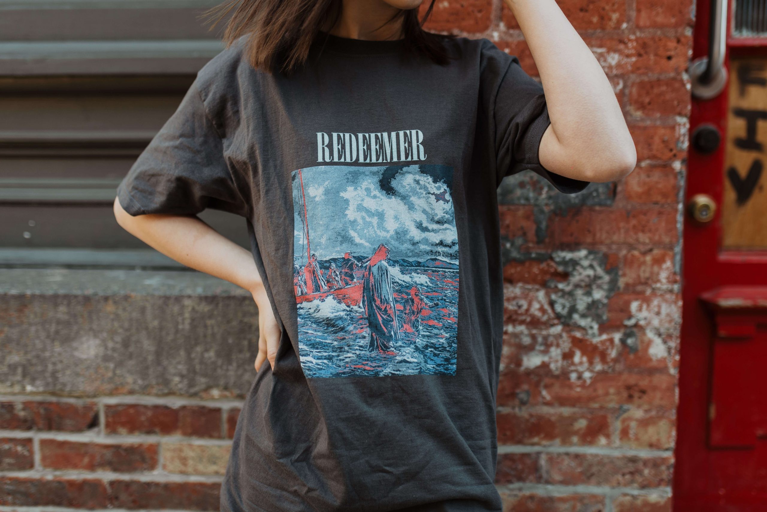 this is a photo of a t-shirt with redeemer on it